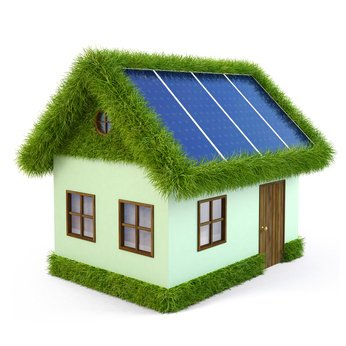 House from the grass with solar panels on the roof. isolated on white.